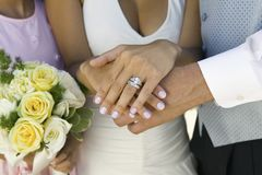Brides hands and wedding ring (close-up) Royalty Free Stock Image