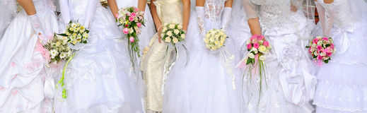 Brides hold bouquets Royalty Free Stock Photos
