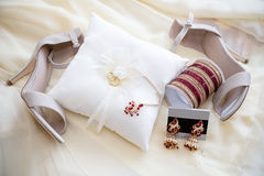 Brides jewelry and shoes Stock Photo