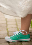 Brides leg. Brides foot in green gym shoe Stock Images