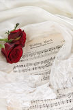 Brides music. Sheet music of the Wedding March with roses and bridal veil stock image