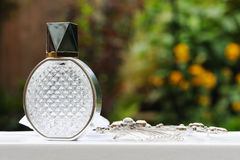 Brides perfume bottle. And hair clip before wedding Stock Image
