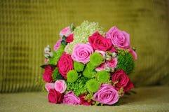 Brides pink roses. Brides pink and red roses at wedding Royalty Free Stock Photo