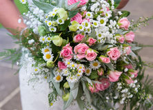 Brides Posy. A close up of a pink and white wedding posy being held by a bride Royalty Free Stock Photography