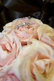 Brides ring in her bridal bouquet Royalty Free Stock Photography