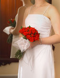 Brides Roses. Detail of Bride holding Bouquet of Red Roses stock image