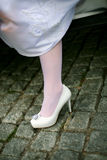 Brides Shoes. Wedding shoe bride emerging from the car after a trip Stock Image