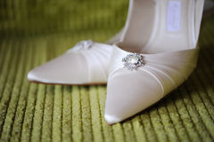 Brides Shoes. Closeup on wedding day Royalty Free Stock Photography