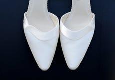 Brides shoes closeup. Pair of brides white shoes closeup stock images