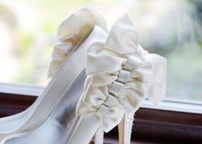 Brides shoes closeup Stock Images