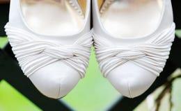 Brides shoes closeup Stock Photos