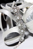 Brides Shoes and Necklace - close up Stock Photo