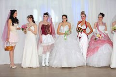 Brides stand at opening of World of Wedding 2011 Royalty Free Stock Image