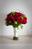 Brides Wedding Bouquet of Red Roses. On stone mantlepiece Stock Image