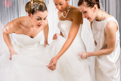 Brides at wedding dress fitting in shop Stock Images