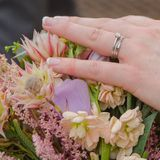 Brides wedding ring with bouquet Stock Images