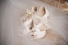Brides wedding shoes and gerter Stock Photography