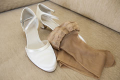 Brides wedding shoes and stockings Stock Photo