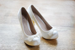 Brides White Shoes. With a on wood Stock Images