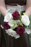 Bridesmaid with bouquet Royalty Free Stock Photo