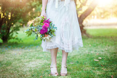 Bridesmaid and bouquet Royalty Free Stock Photos