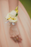 Bridesmaid with boutonniere on hand. Royalty Free Stock Images