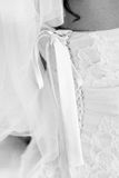 Bridesmaid corset laces on a wedding dress. Stock Images