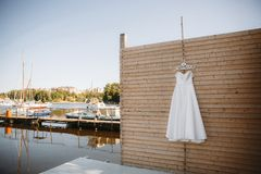 Bridesmaid dress hanging on a wooden wall royalty free stock image