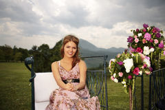 Bridesmaid and flower bouquets in nature Stock Photos
