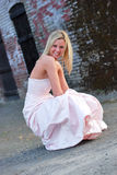 Bridesmaid in Front of Brick Wall - Vertical Stock Image