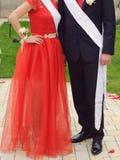 Bridesmaid and Groomsman. Bridesmaid in red dress and groomsman at yard stock photography