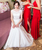 Bridesmaid helping the bride with veil Royalty Free Stock Images