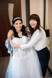 Bridesmaid helps the bride to be prepared for a wedding ceremony Royalty Free Stock Photography