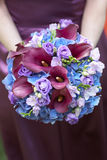 Bridesmaid holding bouquet Stock Image