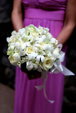 Bridesmaid holding bouquet. Stock Images