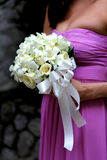 Bridesmaid holding bouquet. royalty free stock image