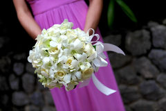 Bridesmaid holding bouquet. Royalty Free Stock Images