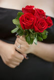 Bridesmaid holding bouquet Royalty Free Stock Images
