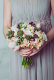 Bridesmaid holding a bouquet of flowers. Royalty Free Stock Photo