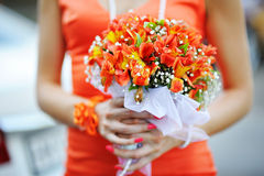 Bridesmaid holding a bouquet of pink Stock Photo