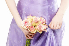 Bridesmaid holding bouquet of pink roses Royalty Free Stock Images