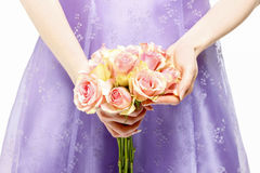 Bridesmaid holding bouquet of pink roses Royalty Free Stock Photo