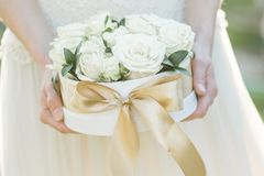 Bridesmaid holding a box of roses. Rose box. Beautiful gift with white roses. Stock Photography