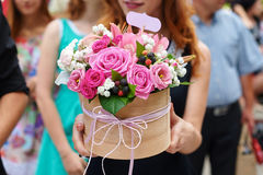 Bridesmaid holding bridal bouquet. On walk in summer park Royalty Free Stock Image