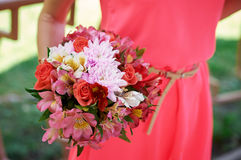 Bridesmaid holding bridal bouquet Stock Photo