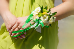 Bridesmaid holding colored wedding bouque Stock Photos