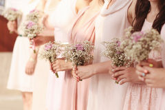 Bridesmaid holding flowers bouquet Royalty Free Stock Photography