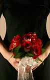 Bridesmaid Holding Roses. Silhouette of bridesmaid holding bouquet of fire and ice roses Royalty Free Stock Photos
