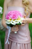 Bridesmaid holding a wedding bouquet Royalty Free Stock Images