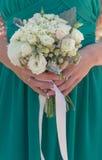 Bridesmaid holding wedding bouquet Stock Photos